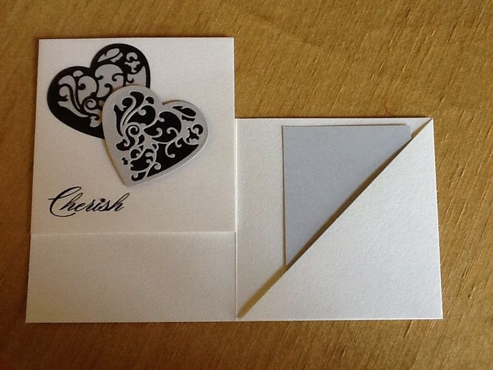 2 Hearts solid color behind with cutout design CHERISH embossed.  Pocket invitation RSVP/Reception...