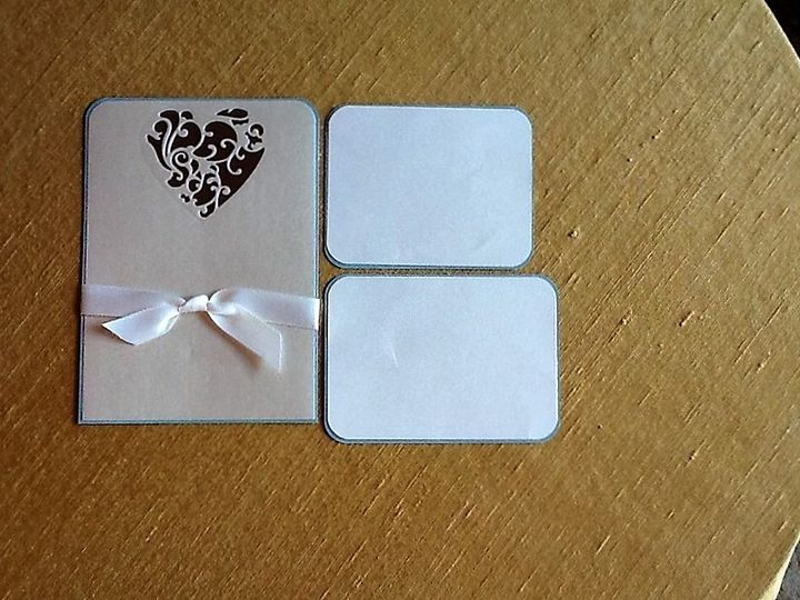 Heart Cutout with ribbon mounted on colored paper. Matching RSVP/Reception card. Price based on...