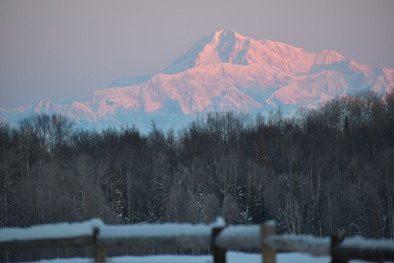 Winter lodge lawn with Denali