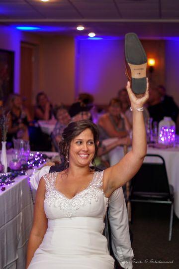 Bride holding a shoe