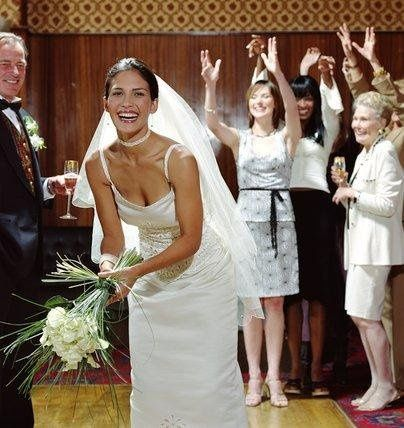 Cheryl about to perform the traditional bouquet toss!