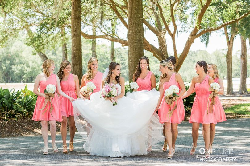 Bridesmaids assisting the bride