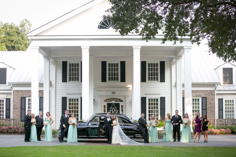 Newlyweds and their guests on the driveway