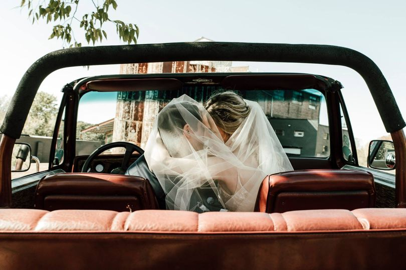 Newlyweds in the jeep
