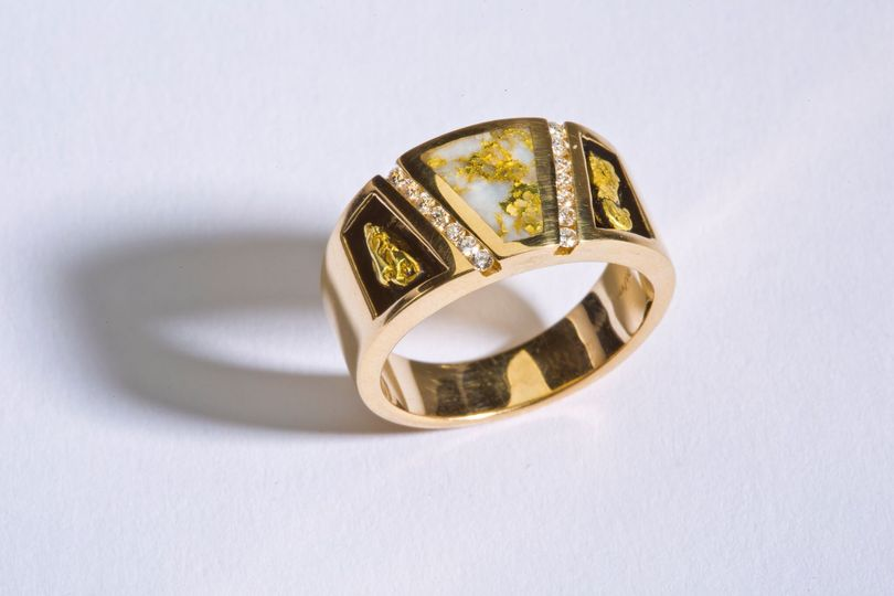 16 to 1 Gold Mine Ring:  $5,900.00  The 16 to 1 gold mine men's ring has gold nuggets embedded in...