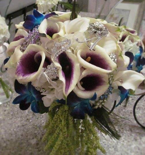 Blue bom dendrobium orchids, white mini calla lilies with Picasso calla lilies and hanging green...