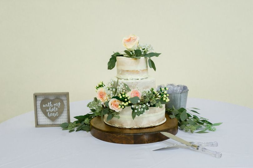 Wedding cake with peachy pink elements