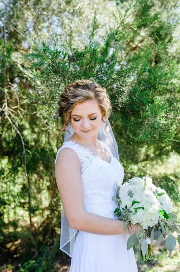 Glowing bride with a fresh floral bouquet