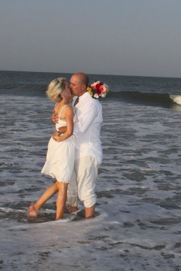 Our bride and groom in the surf on Tybee Island, Georgia.