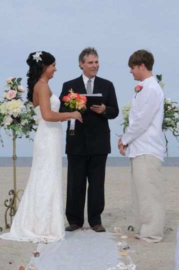 "Our bride and groom at the seashell lined beach ""alter""."
