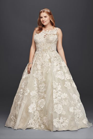 068bc19d Oleg Cassini Style 8CWG658 Lace ball gown with illusion neckline and beaded  lace appliqués.