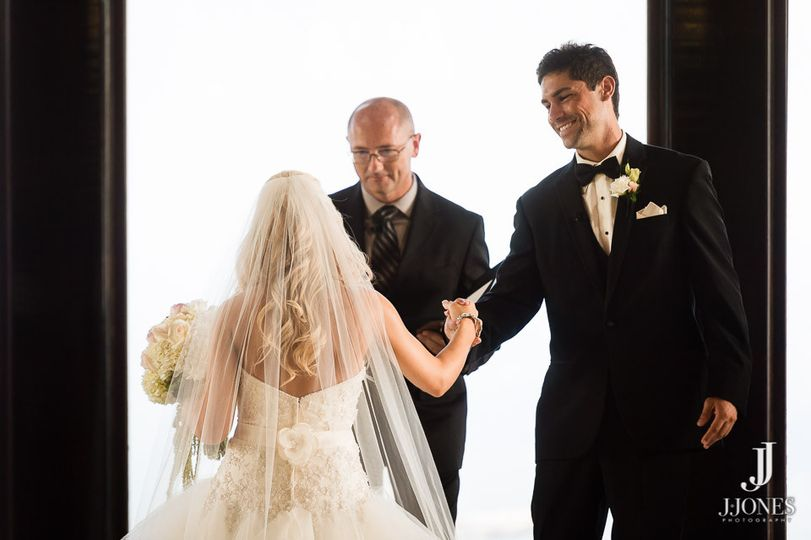 Bride escorted to her groom