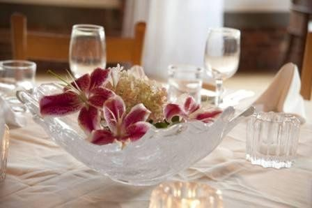 Choose from our selection of Simon Pearce glassware and pottery to personalize your centerpieces