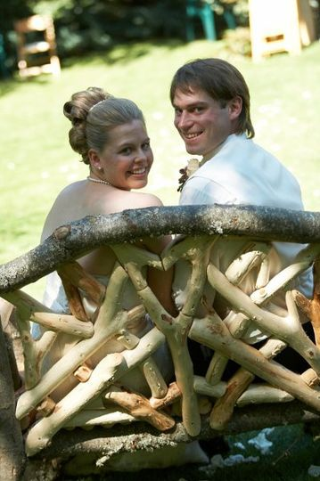 The Bride and Groom relax in a custom chair the Groom crafted for his Bride.