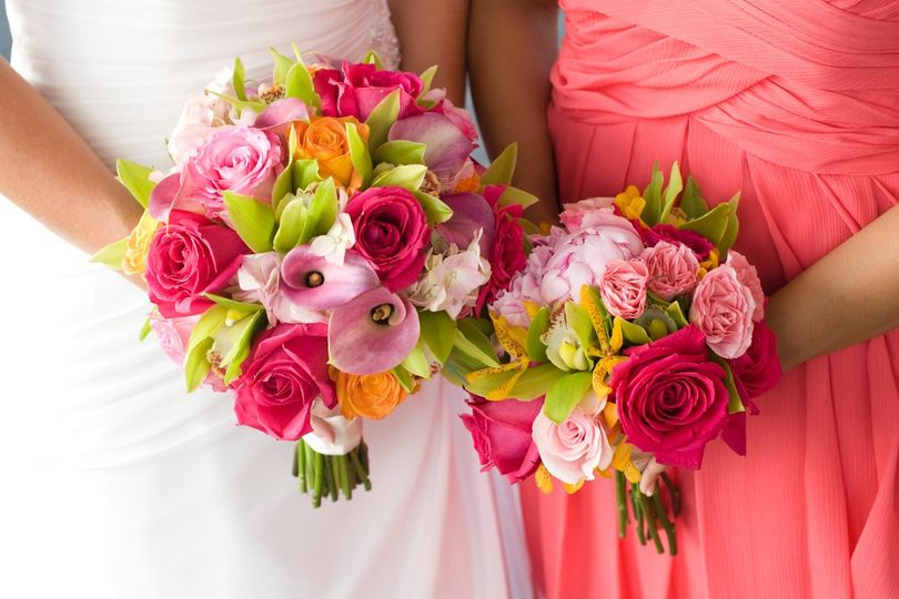 Bride and her bridesmaid holding their bouquet