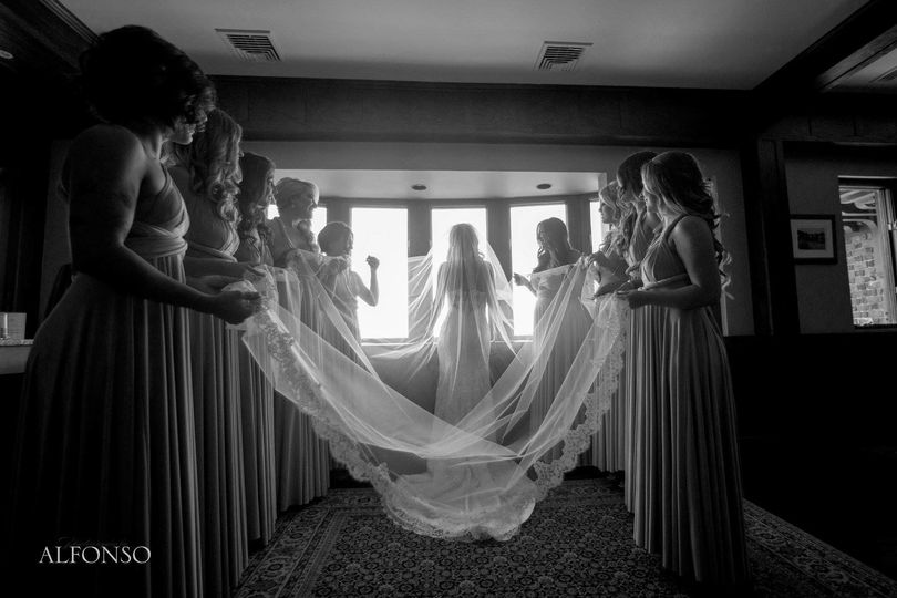 Holding the bride's veil