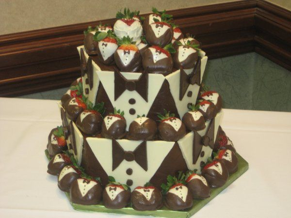 Chocolate grooms cake with chocolate dipped tuxedo strawberries.