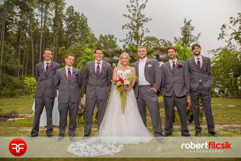 The newlyweds with groomsmen
