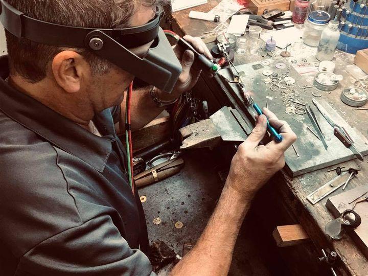 Master bench jeweler at workspace