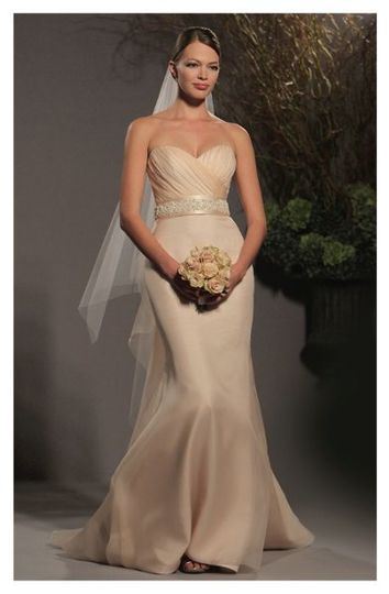 L253- Gown made of silk organza, features a draped sweetheart neckline accented at the waist with a...