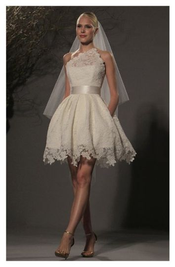 L238 - Wedding dress made of re-embroidered lace, highlights an illusion asymmetrical neckline with...