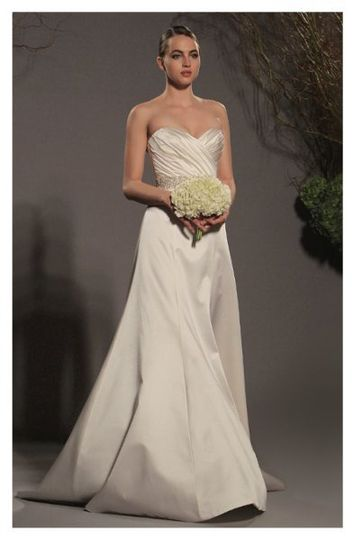 L250 - Gown made of silk satin, features a draped sweetheart neckline spilling into a softly fitted...