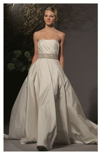 L251 - Strapless ball gown made of silk shantung taffeta, highlights a straight neckline with a...