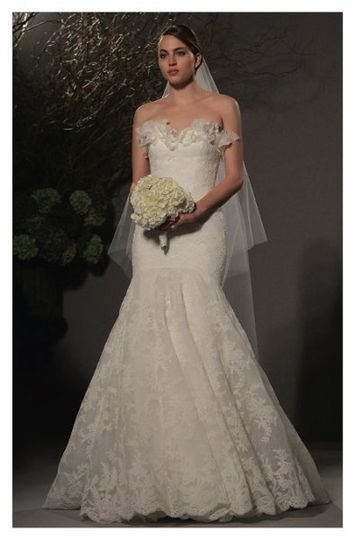 L258 - Strapless gown made of Point d'Esprit lace, highlights a delicately flowering organza...