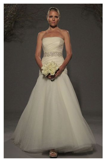 L255 -Mermaid gown made of soft net, features a straight neckline with an asymmetrically draped...