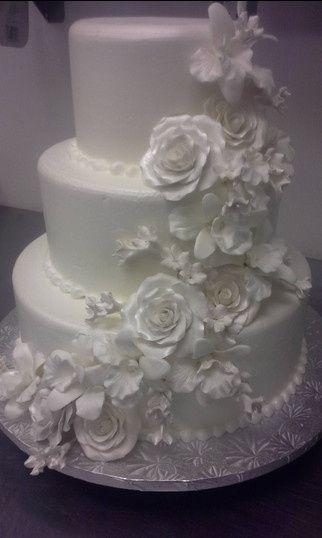 white wedding cake with white roses