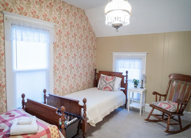 Upstairs room with two twin beds