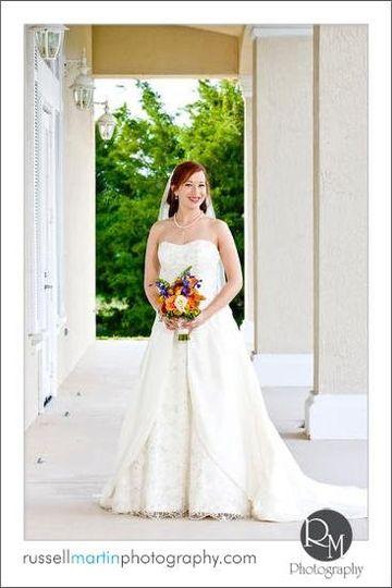 Outdoor ceremony, bride in wedding dress.