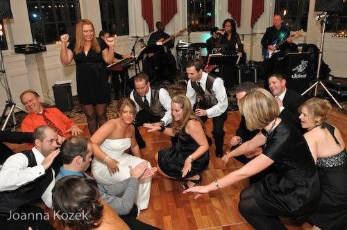 Newlyweds and their guests on the floor