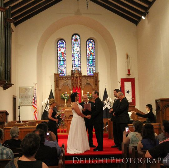 Wedding ceremony at Historic Fort Snelling Memorial Chapel in Minneapolis, MN, with pianist Sharon...