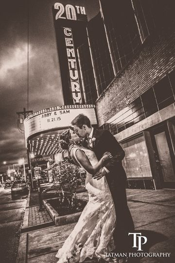 Kiss outside the theater - Tatman Photography