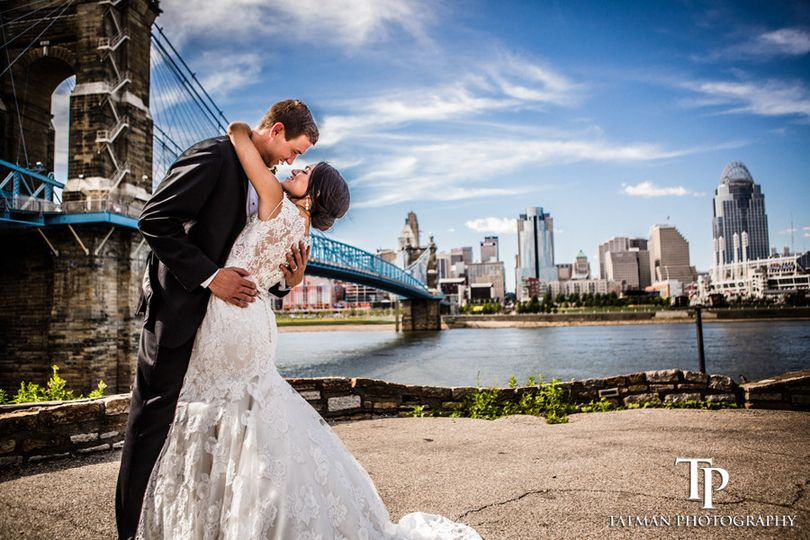 Couple embracing by the bridge - Tatman Photography