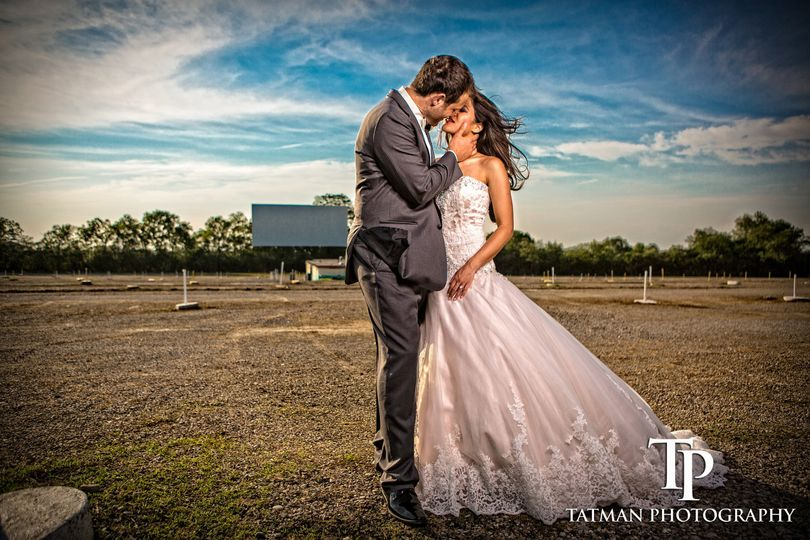 Couple share a kiss - Tatman Photography