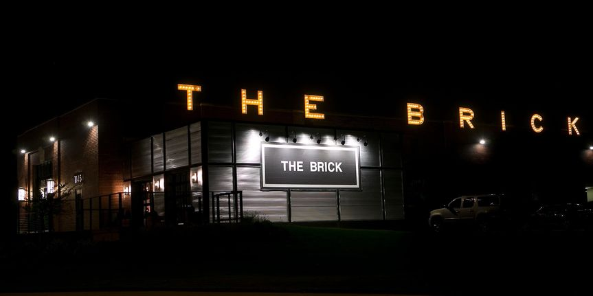 The Brick in lights. Can be seen from across the river as your guests approach.
