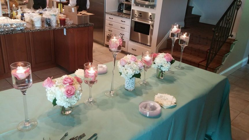 Table set-up with flower and candle centerpiece