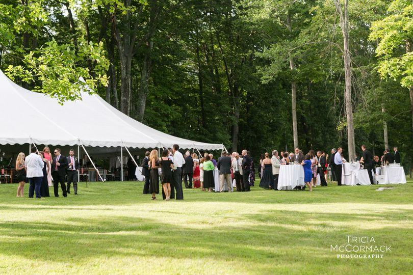 Guest's mingling outside the tent at cocktail hour