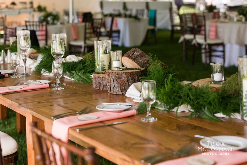 Farm tables to enhance the bride's rustic themed wedding