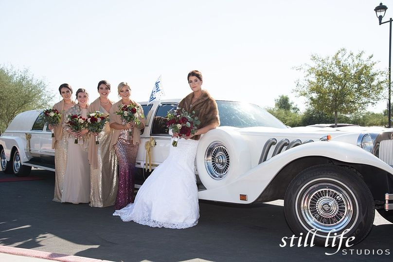 Bridal party by the car