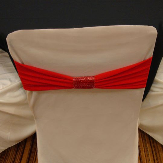red band on ivory standard cover with red bracelet