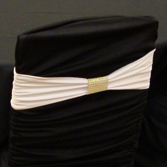 white band on black ruched cover with gold bracele