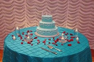 turquoise red wedding cake table waterfall backdro