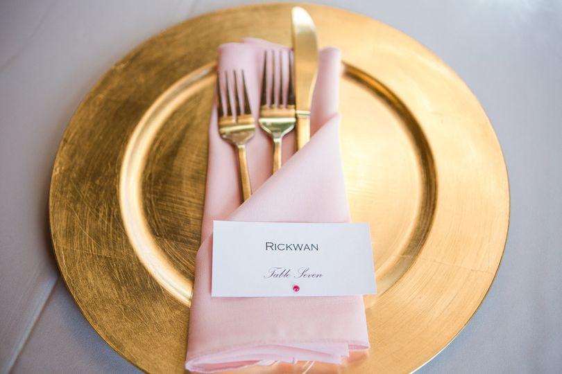 Gold plate with pink table napkin