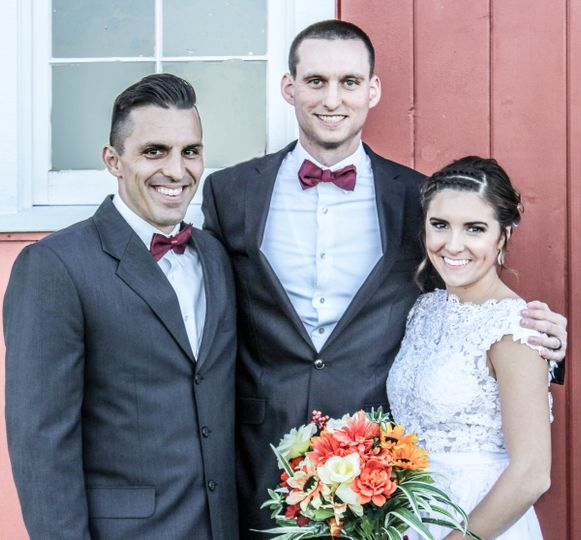 Pastor with Bride and Groom