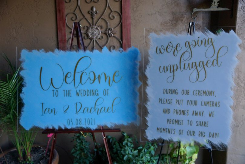 Welcome and unplugged signs