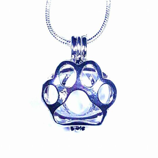 "Show your love for your fur babies with this adorable silver plated paw print!  It comes with an 18""..."