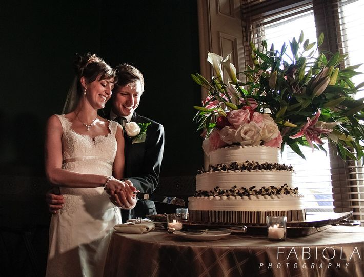 A happy couple and their gorgeous cake.